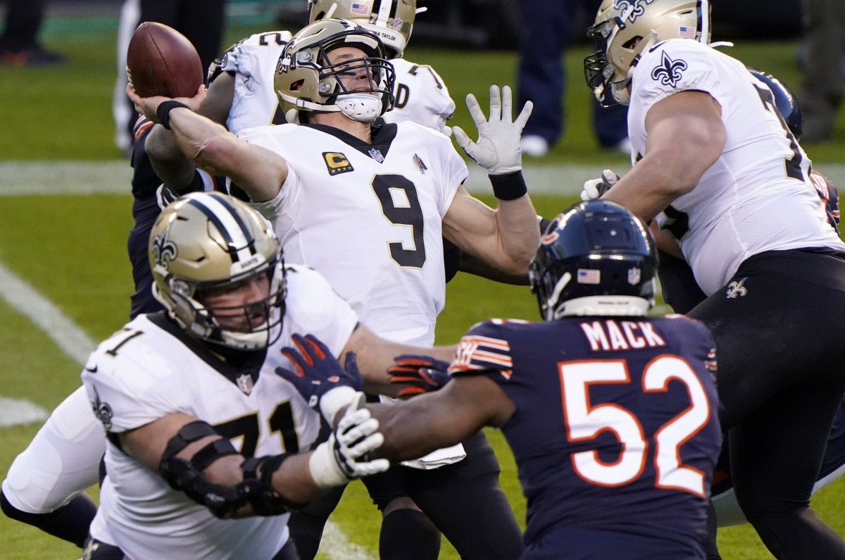 Nov 1, 2020; Chicago, Illinois, USA; New Orleans Saints quarterback Drew Brees (9) drops back to pass against the Chicago Bears during the second quarter at Soldier Field. Mandatory Credit: Mike Dinovo-USA TODAY