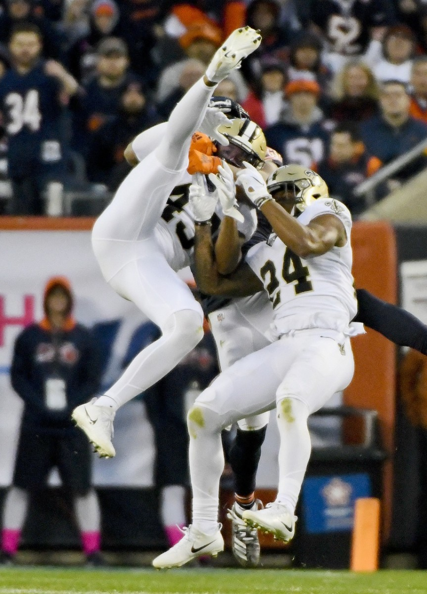 Oct 20, 2019; Chicago, IL, USA; New Orleans Saints free safety Marcus Williams (43) and strong safety Vonn Bell (24) fight for a pass with Chicago Bears wide receiver Allen Robinson (12) during the second half at Soldier Field. Mandatory Credit: Matt Marton-USA TODAY