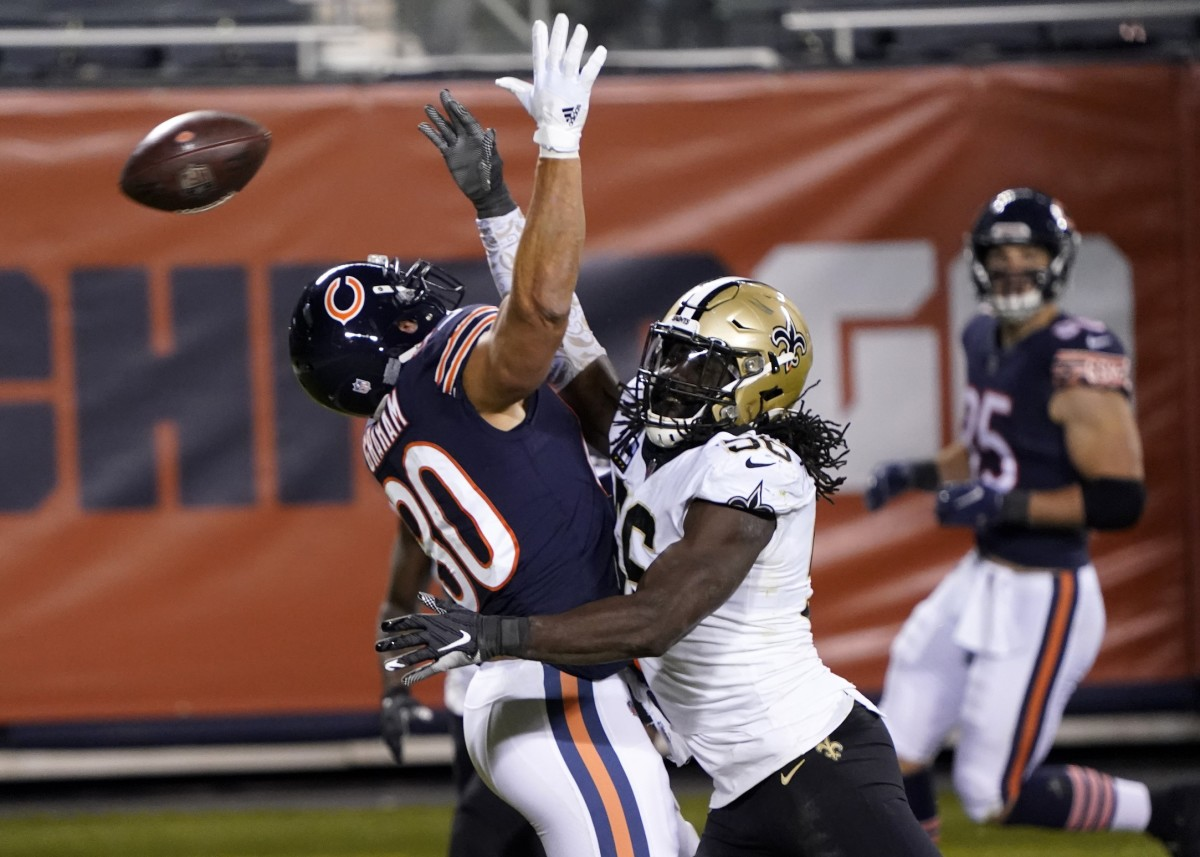 Nov 1, 2020; Chicago, Illinois, USA; New Orleans Saints outside linebacker Demario Davis (56) on Chicago Bears tight end Jimmy Graham (80) during the fourth quarter at Soldier Field. Mandatory Credit: Mike Dinovo-USA TODAY Sports