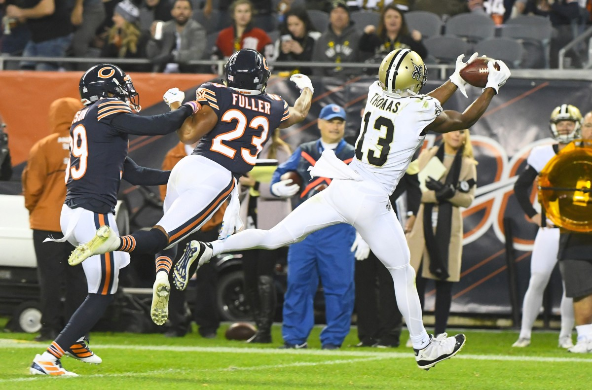 Oct 20, 2019; Chicago, IL, USA; New Orleans Saints wide receiver Michael Thomas (13) makes a catch against Chicago Bears cornerback Kyle Fuller (23) during the second half at Soldier Field. Mandatory Credit: Mike DiNovo-USA TODAY