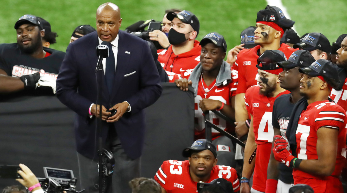 Big Ten commissioner Kevin Warren introduces the Ohio State Buckeyes after their victory over the Northwestern Wildcats at conference championship.