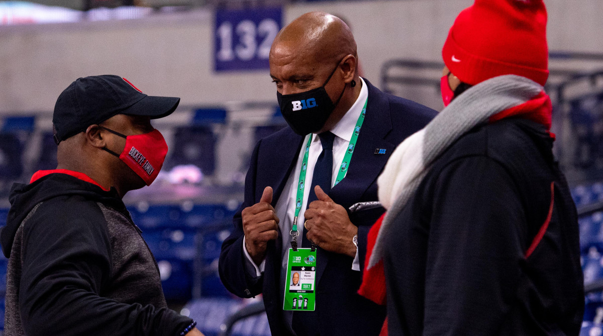 Big Ten Conference commissioner Kevin Warren visits with fans in the stands before the start of the Big Ten Championship game between Ohio State and Northwestern at Lucas Oil Stadium.