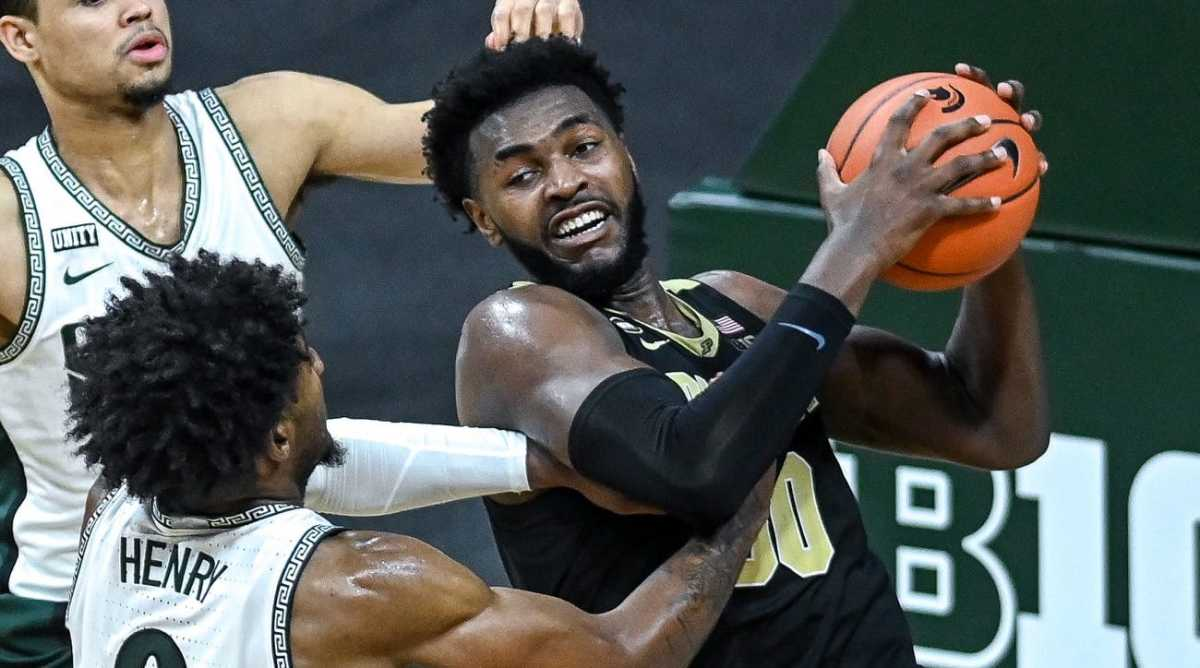 Michigan State's Aaron Henry, left, fouls Purdue's Trevion Williams during the second half on Friday, Jan. 8, 2021, at the Breslin Center in East Lansing.