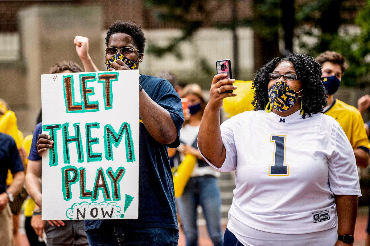 Big Ten fans hold up 'Let Them Play' signs