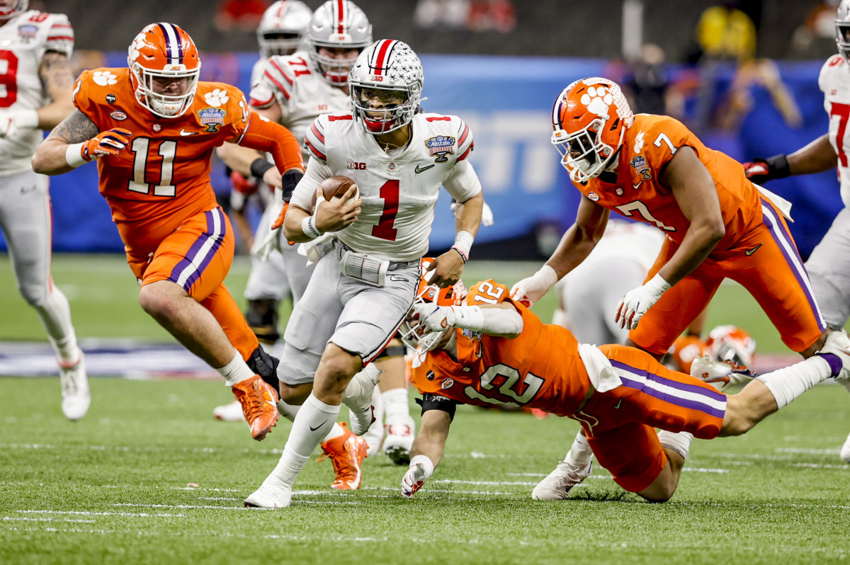 Ohio State QB Justin Fields runs during the playoff semifinal