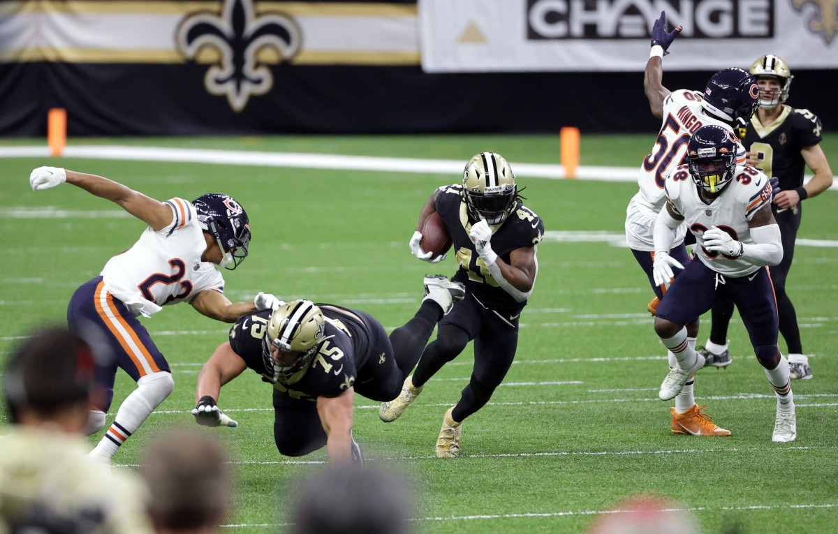 Jan 10, 2021; New Orleans, Louisiana, USA; New Orleans Saints running back Alvin Kamara (41) runs the ball as offensive during the second half in the NFC Wild Card game at Mercedes-Benz Superdome. Mandatory Credit: Derick E. Hingle-USA TODAY