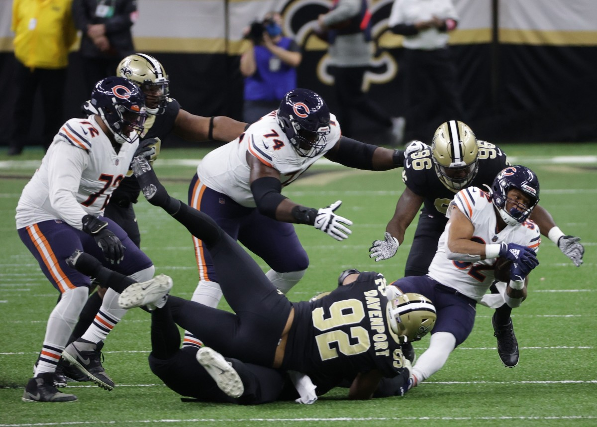 Jan 10, 2021; New Orleans, Louisiana, USA; Chicago Bears running back David Montgomery (32) is brought down by New Orleans Saints defensive end Marcus Davenport (92) and defensive end Carl Granderson (96) during the first half in the NFC Wild Card game at Mercedes-Benz Superdome. Mandatory Credit: Derick E. Hingle-USA TODAY