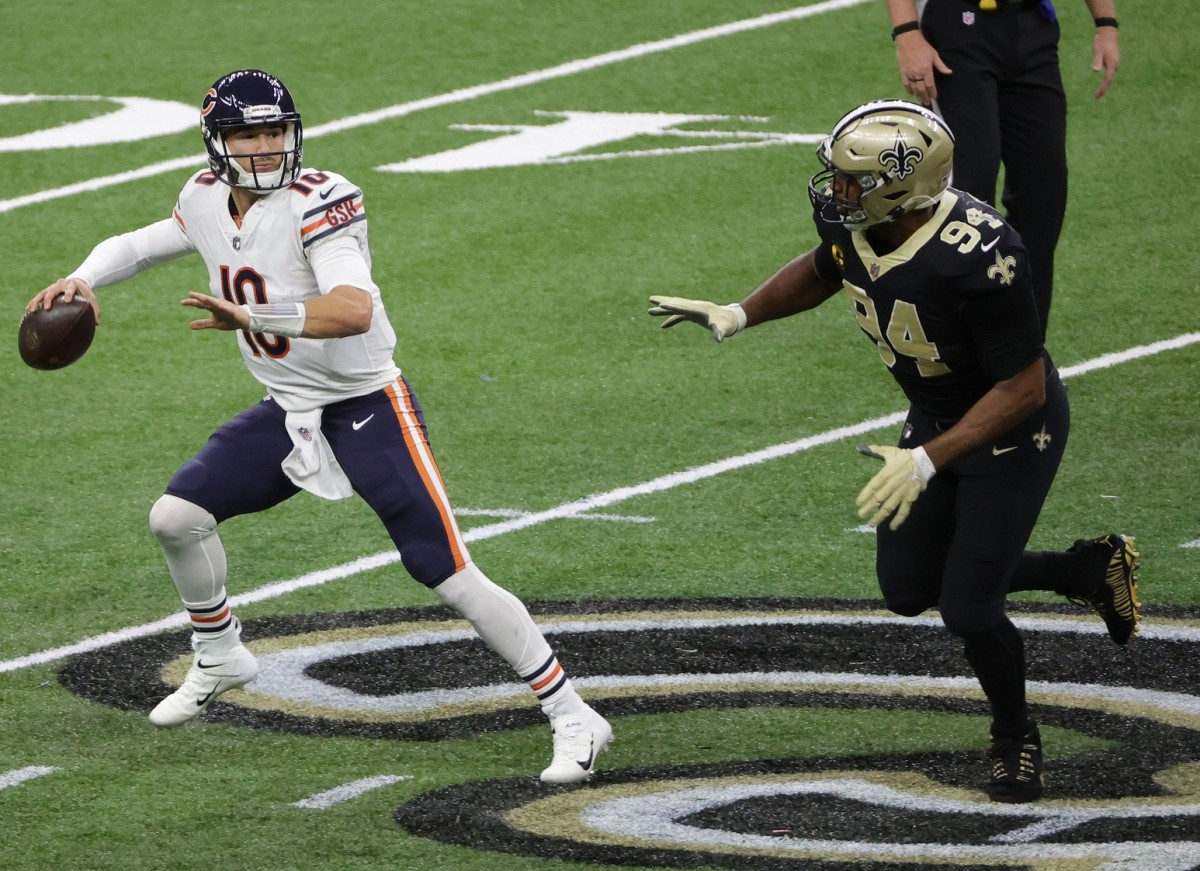 Jan 10, 2021; New Orleans, Louisiana, USA; Chicago Bears quarterback Mitchell Trubisky (10) throws under pressure against New Orleans Saints defensive end Cameron Jordan (94) during the second half in the NFC Wild Card game at Mercedes-Benz Superdome. Mandatory Credit: Derick E. Hingle-USA TODAY Sports