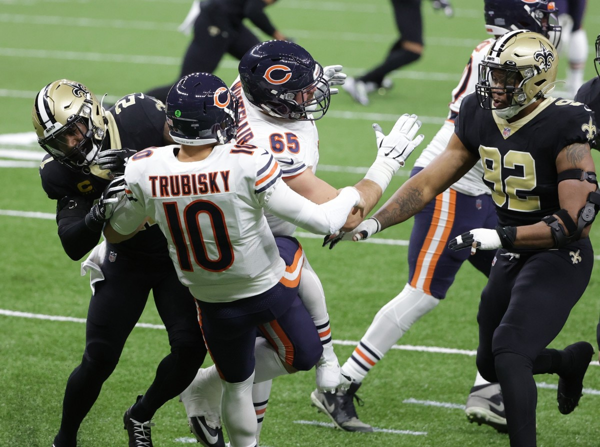 Jan 10, 2021; New Orleans, Louisiana, USA; Chicago Bears quarterback Mitchell Trubisky (10) is brought down by New Orleans Saints cornerback Patrick Robinson (21) during the first half in the NFC Wild Card game at Mercedes-Benz Superdome. Mandatory Credit: Derick E. Hingle-USA TODAY