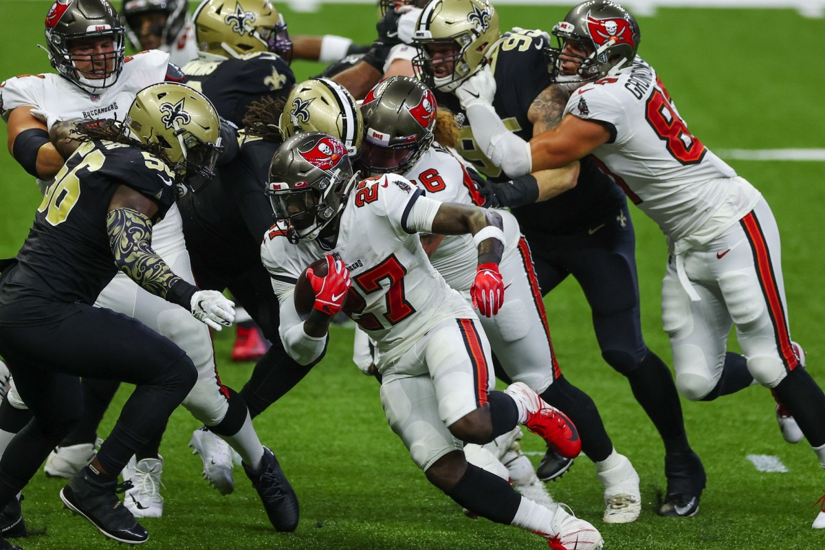 Sep 13, 2020; New Orleans, Louisiana, USA; Tampa Bay running back Ronald Jones II (27) runs against the New Orleans Saints during the first quarter at the Mercedes-Benz Superdome. Mandatory Credit: Derick E. Hingle-USA TODAY