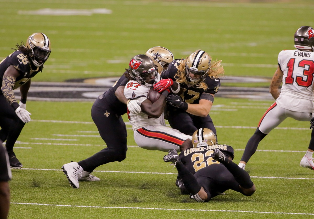 Sep 13, 2020; New Orleans, Louisiana, USA; New Orleans Saints defensive end Cameron Jordan (94) and linebacker Alex Anzalone (47) and safety C.J. Gardner-Johnson (22) tackle Buccaneers running back Ronald Jones II (27) during the second half at the Mercedes-Benz Superdome. Mandatory Credit: Derick E. Hingle-USA TODAY Sports