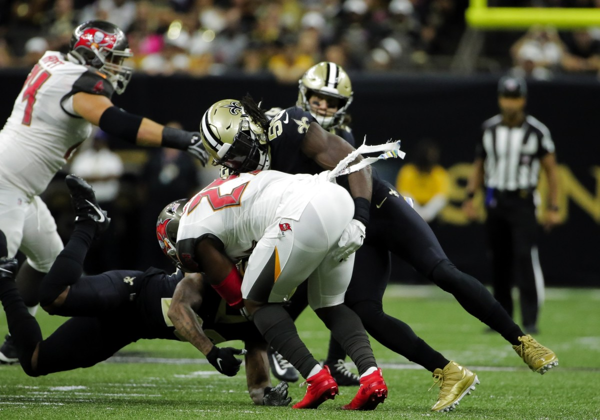 Oct 6, 2019; New Orleans, LA, USA; Tampa Bay running back Ronald Jones (27) runs the ball against New Orleans Saints defensive tackle David Onyemata (93) in the second quarter at the Mercedes-Benz Superdome. Mandatory Credit: Chuck Cook-USA TODAY
