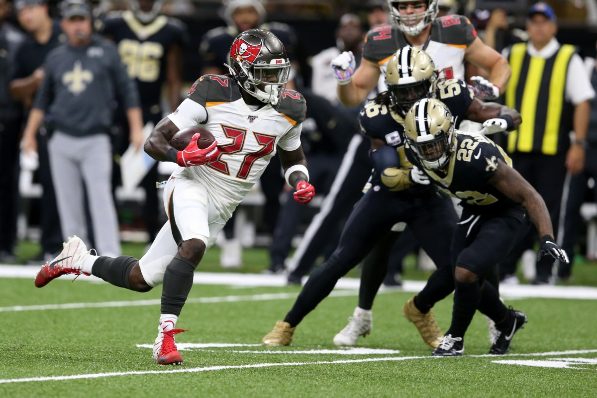 Oct 6, 2019; New Orleans, LA, USA; Buccaneers running back Ronald Jones (27) runs the ball against New Orleans Saints defensive back Chauncey Gardner-Johnson (22) in the second quarter at the Mercedes-Benz Superdome. Mandatory Credit: Chuck Cook-USA TODAY Sports