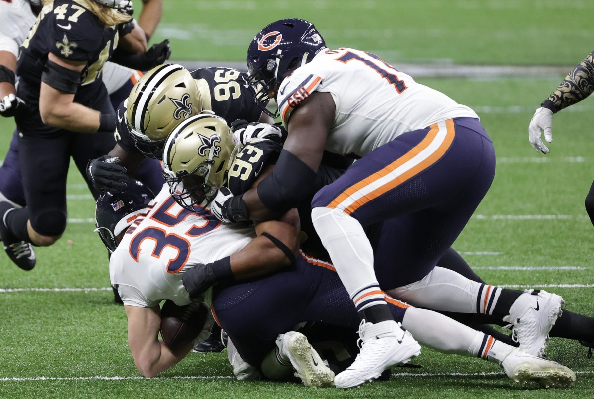 Jan 10, 2021; New Orleans, Louisiana, USA; Bears running back Ryan Nall (35) is brought down by New Orleans defensive tackle David Onyemata (93) and defensive end Carl Granderson (96) during the first half in the NFC Wild Card game at Mercedes-Benz Superdome. Mandatory Credit: Derick E. Hingle-USA TODAY