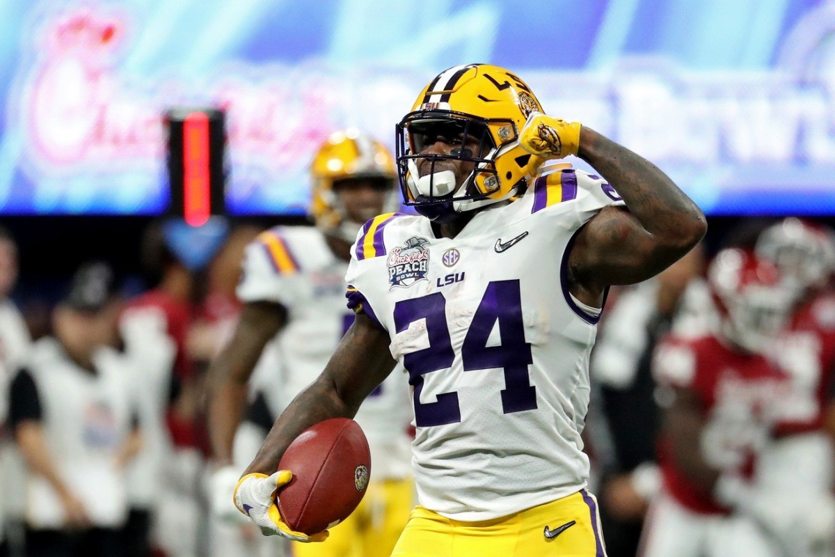 Dec 28, 2019; Atlanta, Georgia, USA; LSU Tigers running back Chris Curry (24) reacts after a run during the 2019 Peach Bowl college football playoff semifinal game against the Oklahoma Sooners at Mercedes-Benz Stadium.