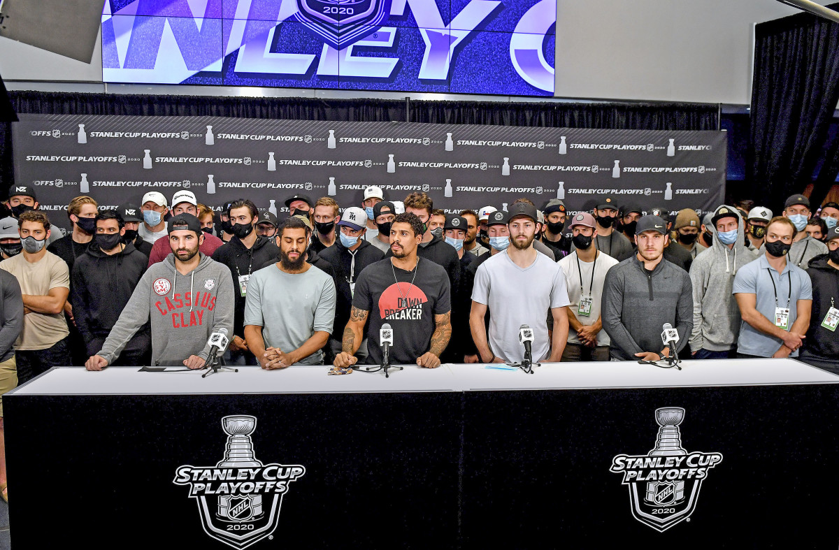 Nazem Kadri (left, in Cassius Clay sweatshirt) was the only HDA member left in the playoffs when the Jacob Blake shooting happened; he spoke alongside other players after play stopped following Blake's shooting.