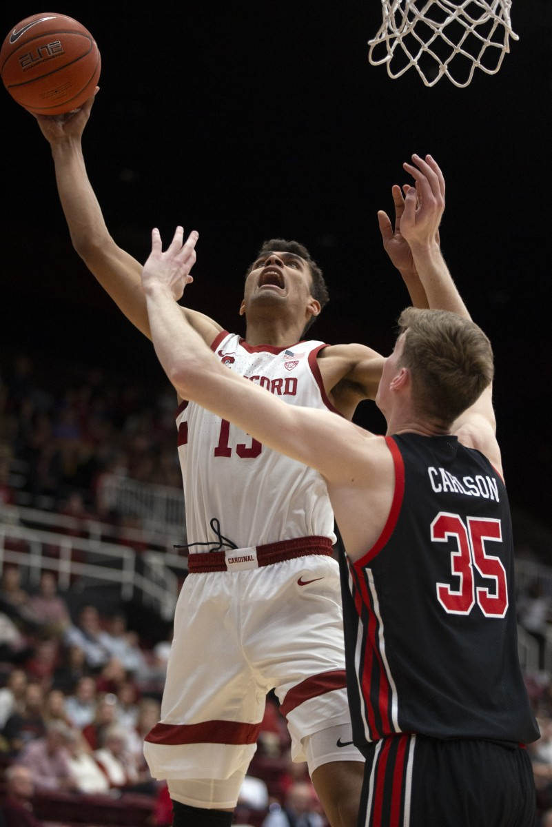 Feb 26, 2020; Stanford, California, USA; Stanford Cardinal forward Oscar da Silva (13) shoots over Utah Utes center Branden Carlson (35) during the first half of an NCAA college basketball game at Maples Pavilion.