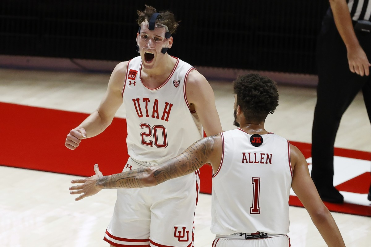Jan 9, 2021; Salt Lake City, Utah, USA; Utah Utes forward Mikael Jantunen (20) reacts with forward Timmy Allen (1) after a basket in the final seconds of the first half against the Oregon Ducks at Jon M. Huntsman Center.