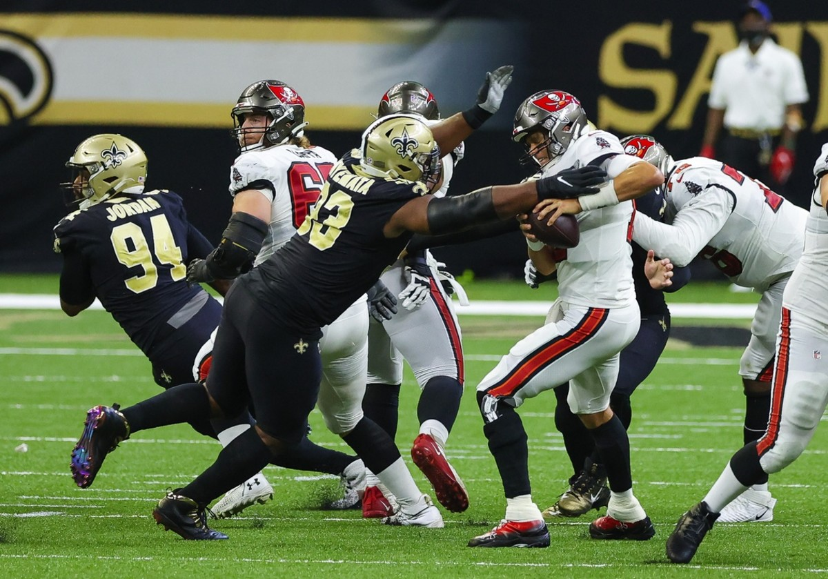 Sep 13, 2020; New Orleans, Louisiana, USA; Tampa Bay Buccaneers quarterback Tom Brady (12) is pressured by New Orleans Saints defensive tackle David Onyemata (93) during the fourth quarter at the Mercedes-Benz Superdome. Mandatory Credit: Derick E. Hingle-USA TODAY
