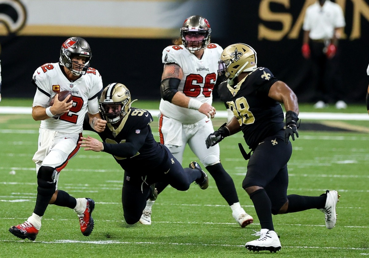 Sep 13, 2020; New Orleans, Louisiana, USA; New Orleans Saints defensive end Trey Hendrickson (91) tackles Tampa Bay quarterback Tom Brady (12) during the fourth quarter at the Mercedes-Benz Superdome. Mandatory Credit: Derick E. Hingle-USA TODAY