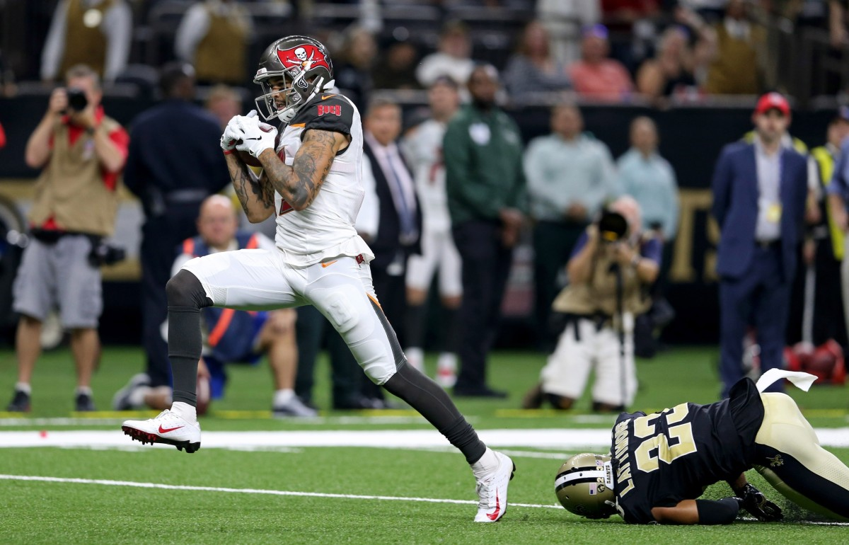 Sep 9, 2018; New Orleans, LA, USA; Tampa Bay wide receiver Mike Evans (13) hauls in a pass for a touchdown while defended by Saints cornerback Marshon Lattimore (23) in the third quarter at the Mercedes-Benz Superdome. The Bucs won, 48-40. Mandatory Credit: Chuck Cook-USA TODAY