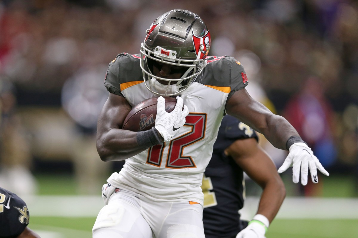 Oct 6, 2019; New Orleans, LA, USA; Tampa Bay Buccaneers wide receiver Chris Godwin (12) runs after a catch in the second quarter against the New Orleans Saints at the Mercedes-Benz Superdome. Mandatory Credit: Chuck Cook-USA TODAY