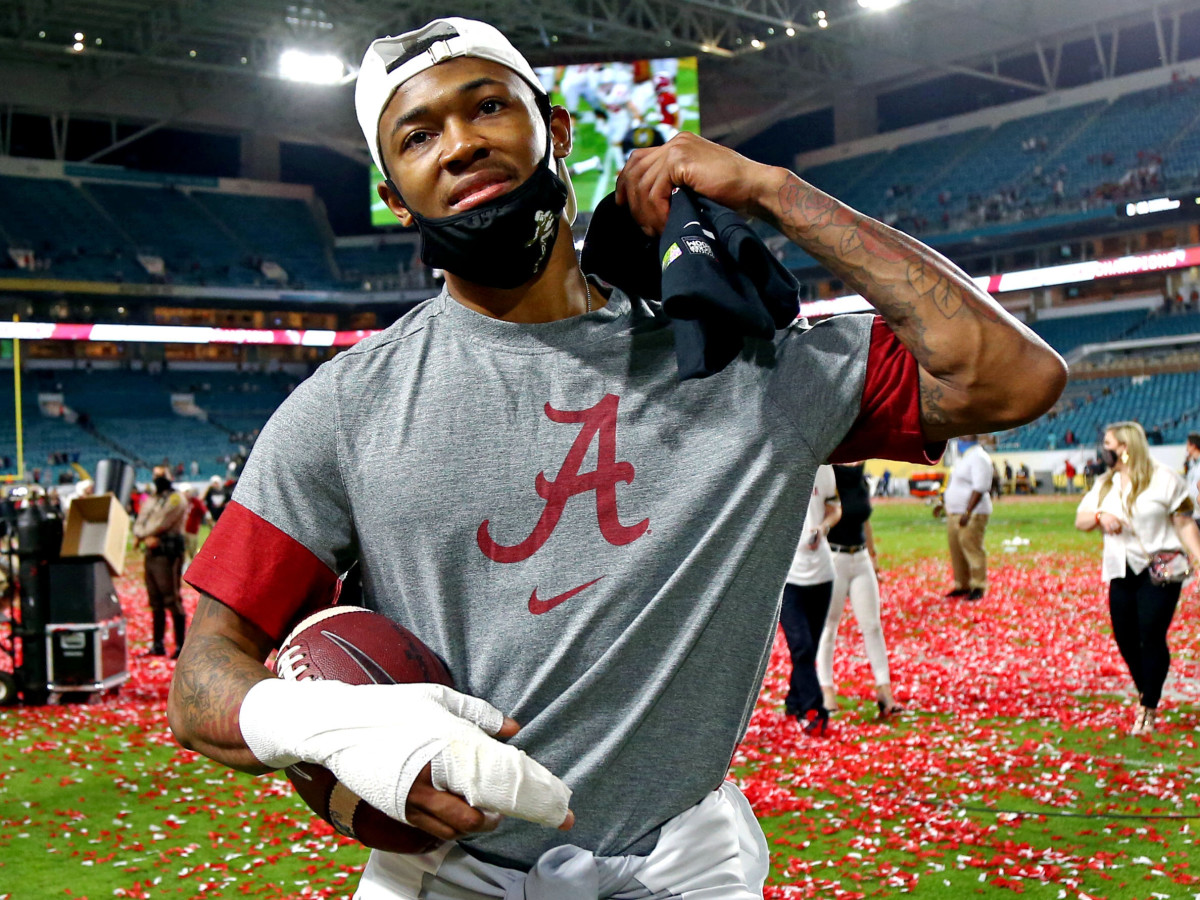 Jan 11, 2021; Miami Gardens, Florida, USA; Alabama Crimson Tide wide receiver DeVonta Smith (6) celebrates after defeating the Ohio State Buckeyes in the 2021 College Football Playoff National Championship Game.