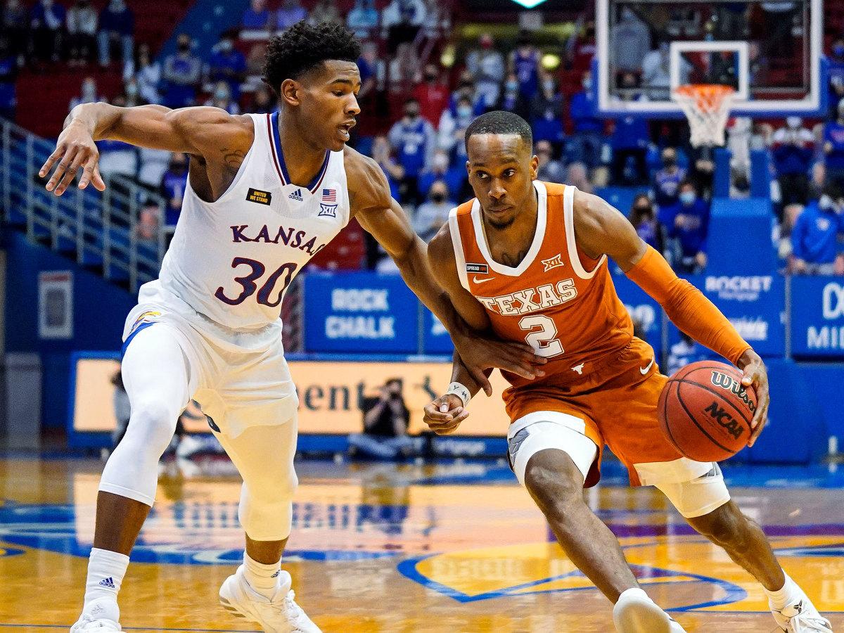 Texas' Matt Coleman drives vs. Kansas