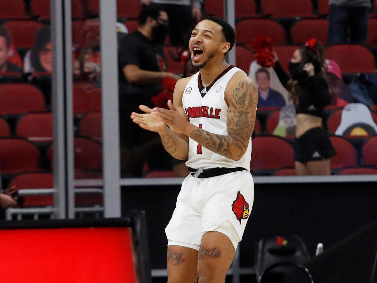 Louisville's Carlik Jones claps during a game