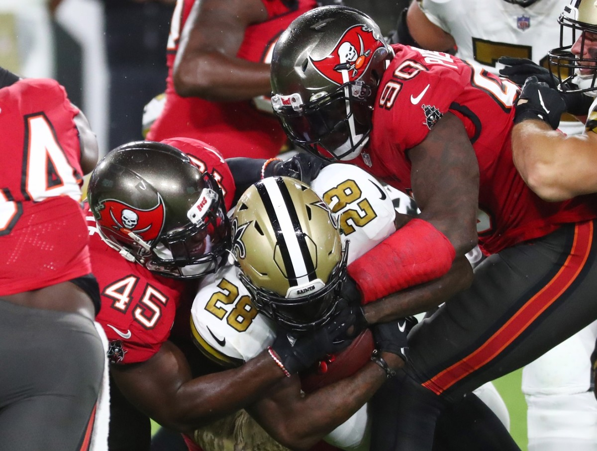 Nov 8, 2020; Tampa, Florida, USA; Saints running back Latavius Murray (28) is tackled by Tampa Bay inside linebacker Devin White (45) and outside linebacker Jason Pierre-Paul (90) in the first quarter of a NFL game at Raymond James Stadium. Mandatory Credit: Kim Klement-USA TODAY