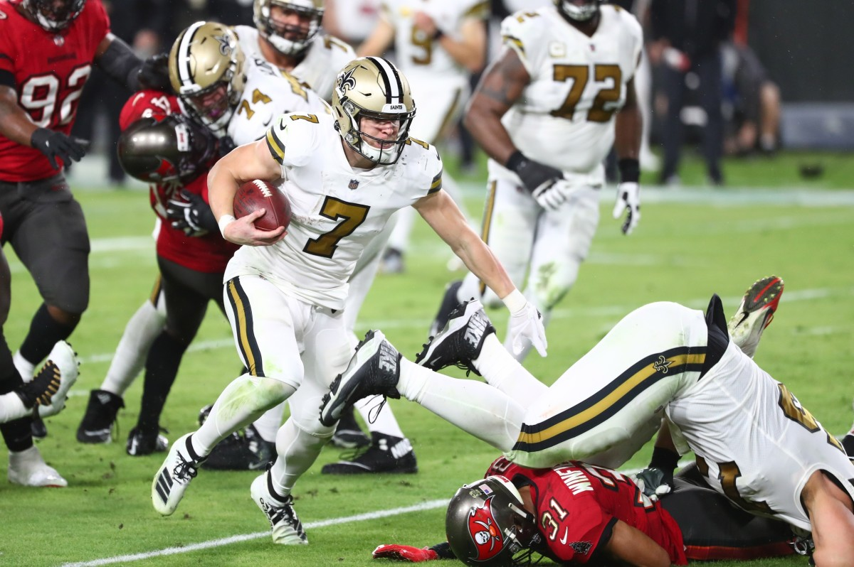 Nov 8, 2020; Tampa, Florida, USA; New Orleans Saints quarterback Taysom Hill (7) runs with the ball against the Tampa Bay Buccaneers during the first half at Raymond James Stadium. Mandatory Credit: Kim Klement-USA TODAY