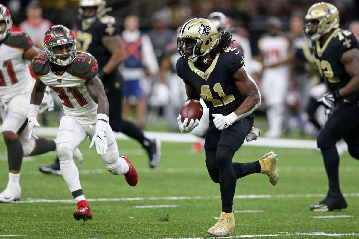 Oct 6, 2019; New Orleans, LA, USA; Saints running back Alvin Kamara (41) runs the ball against Buccaneers free safety Jordan Whitehead (31) in the second half at the Mercedes-Benz Superdome. Mandatory Credit: Chuck Cook-USA TODAY