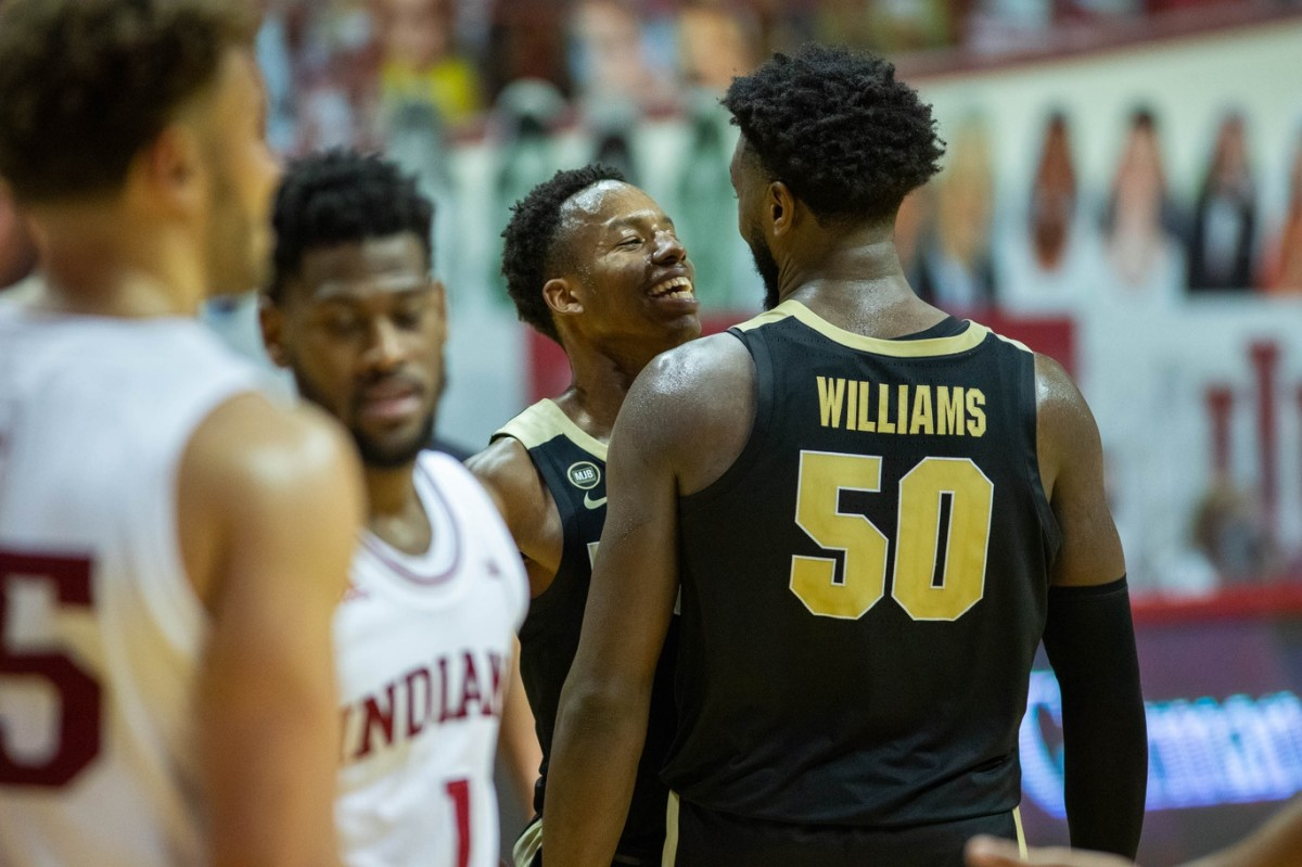 SMILES & FROWNS: Purdue's Eric Hunter Jr. and Trevion Williams celebrate a basket while Indiana's Al Durham drops his head. (USA TODAY Sports)