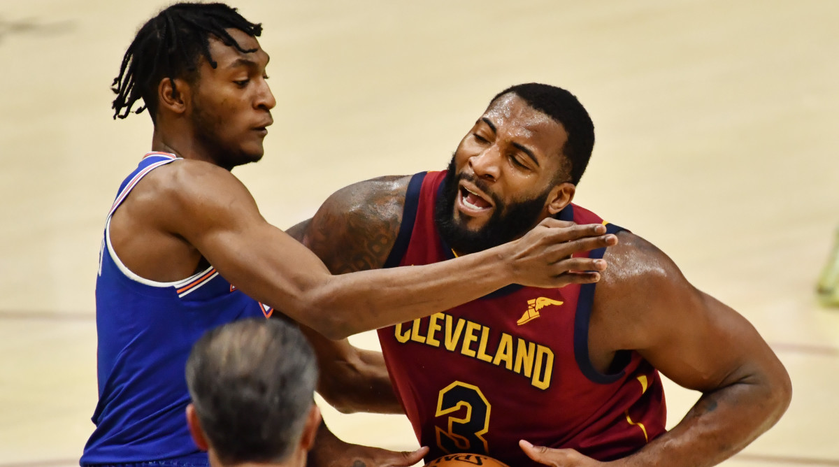 Cleveland Cavaliers center Andre Drummond (3) drives to the basket against New York Knicks guard Immanuel Quickley (left) during the first quarter at Rocket Mortgage FieldHouse.