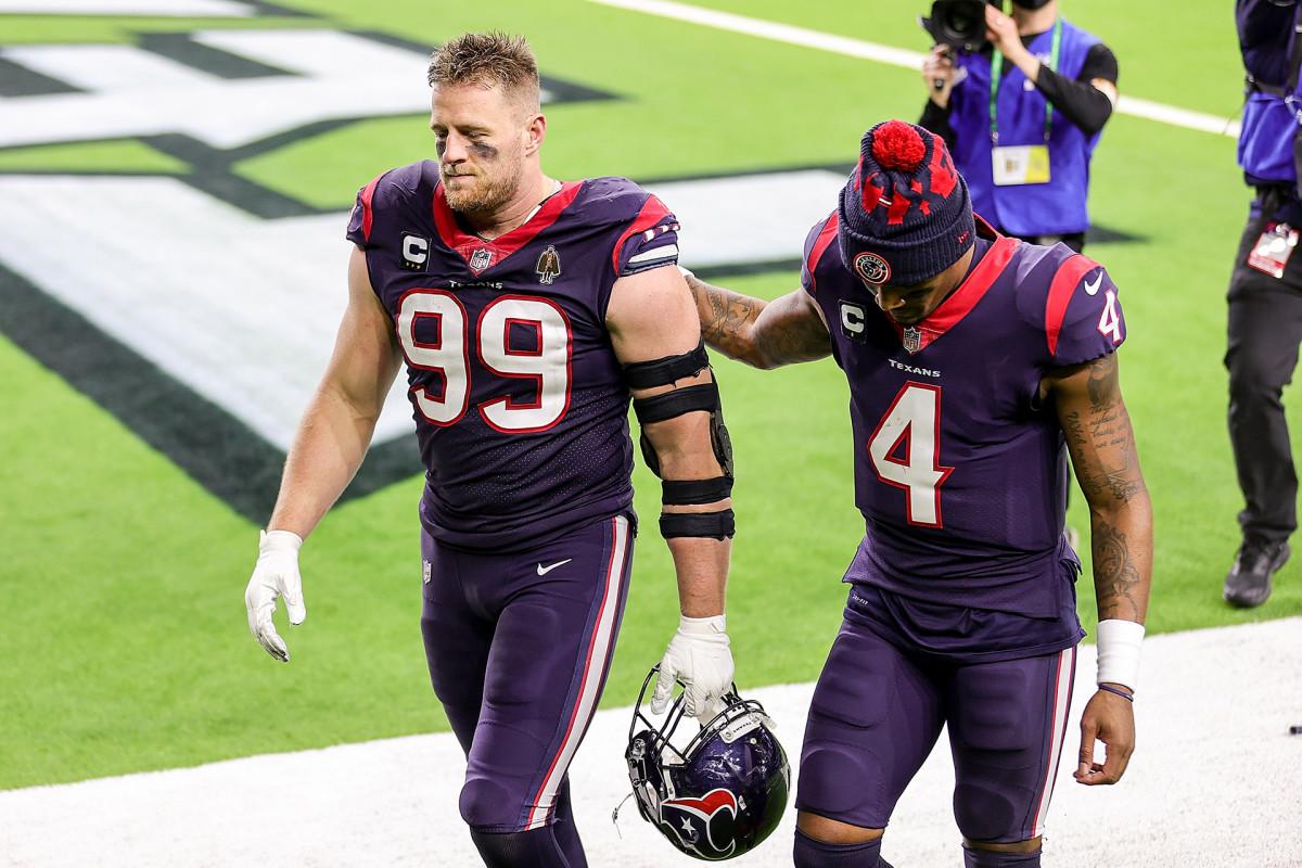 JJ Watt and Deshaun Watson walk off the field after a Texans loss