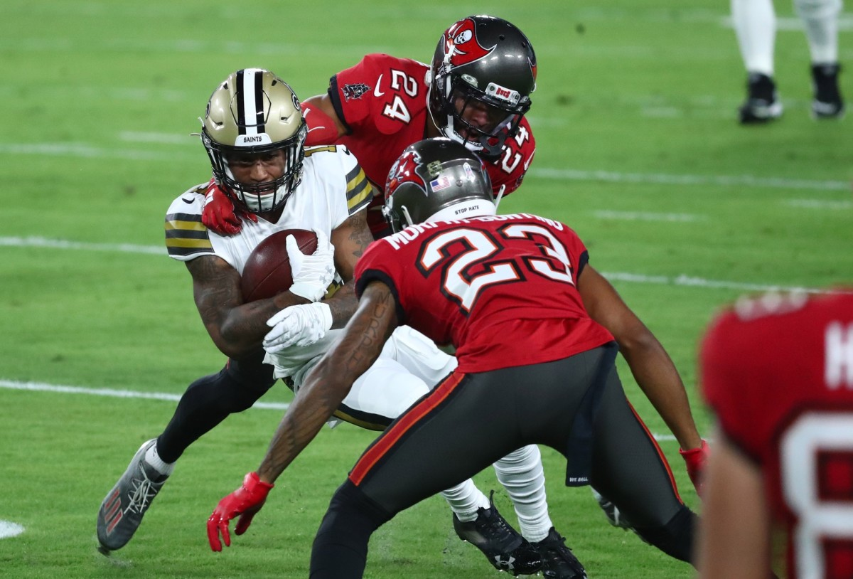 Nov 8, 2020; Tampa, Florida, USA; Saints wide receiver Deonte Harris (11) catches the ball between Tampa Bay cornerback Carlton Davis (24) and cornerback Sean Murphy-Bunting (23) in the first quarter of a NFL game at Raymond James Stadium. Mandatory Credit: Kim Klement-USA TODAY