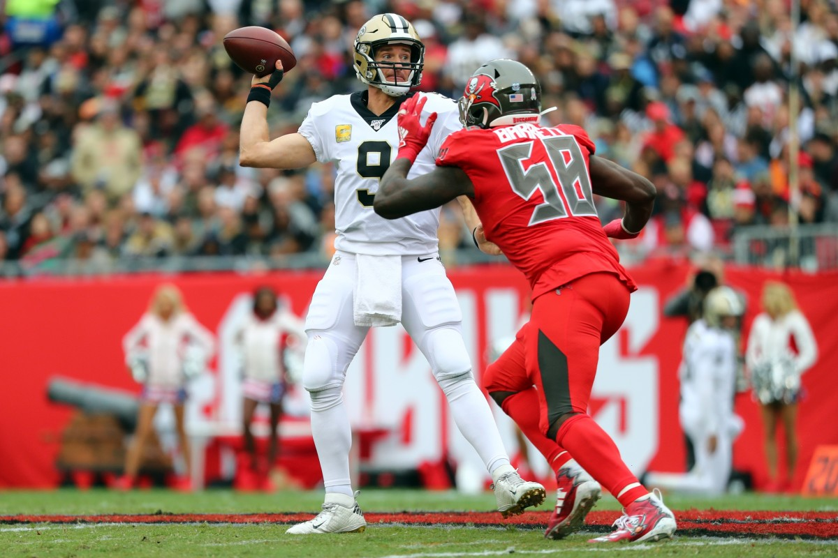Nov 17, 2019; Tampa, FL, USA; New Orleans Saints quarterback Drew Brees (9) throws the ball against Tampa Bay Buccaneers linebacker Shaquil Barrett (58) during the first half at Raymond James Stadium. Mandatory Credit: Kim Klement-USA TODAY