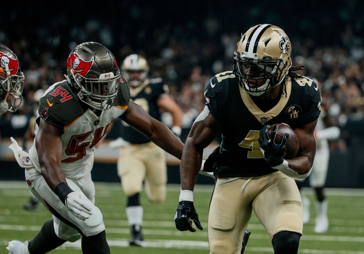 Sep 9, 2018; New Orleans, LA, USA; New Orleans Saints running back Alvin Kamara (41) runs past Tampa Bay Buccaneers linebacker Lavonte David (54) during the first quarter of a game at the Mercedes-Benz Superdome. Mandatory Credit: Derick E. Hingle-USA TODAY