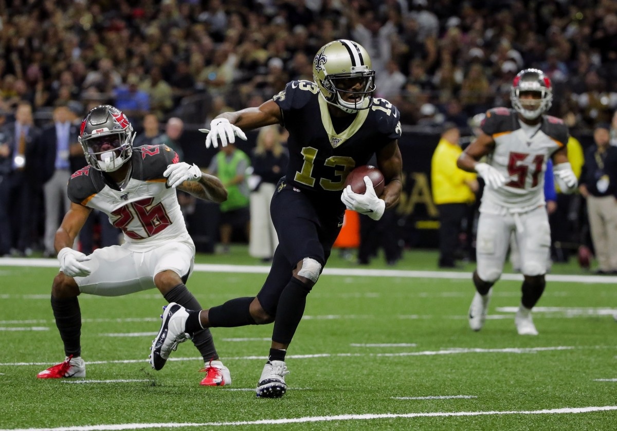 Oct 6, 2019; New Orleans, LA, USA; Saints wide receiver Michael Thomas (13) breaks away from Buccaneers defensive back Sean Murphy-Bunting (26) for a touchdown during the fourth quarter at the Mercedes-Benz Superdome. Mandatory Credit: Derick E. Hingle-USA TODAY Sports