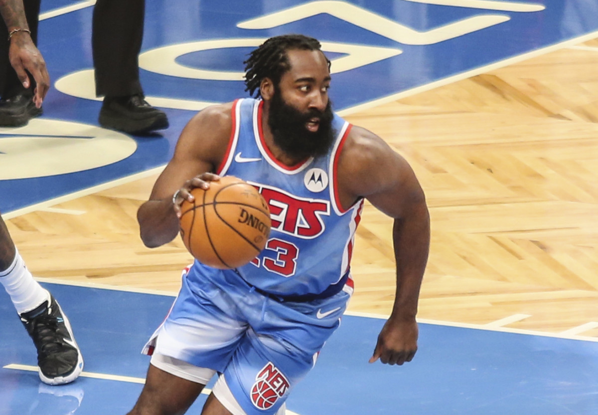 Brooklyn Nets guard James Harden dribbles in his Brooklyn Nets debut