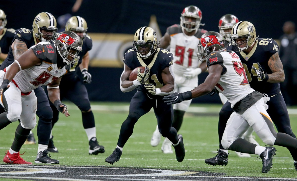 Nov 5, 2017; New Orleans, LA, USA; New Orleans Saints running back Alvin Kamara (41) runs with Tampa Bay Buccaneers outside linebacker Lavonte David (54) defending in the second half at the Mercedes-Benz Superdome. The Saints won, 30-10. Mandatory Credit: Chuck Cook-USA TODAY Sports