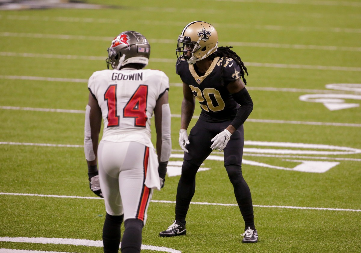 Sep 13, 2020; New Orleans, Louisiana, USA; New Orleans Saints cornerback Janoris Jenkins (20) defends Tampa Bay Buccaneers wide receiver Chris Godwin (14) during the second half at the Mercedes-Benz Superdome. Mandatory Credit: Derick E. Hingle-USA TODAY Sports