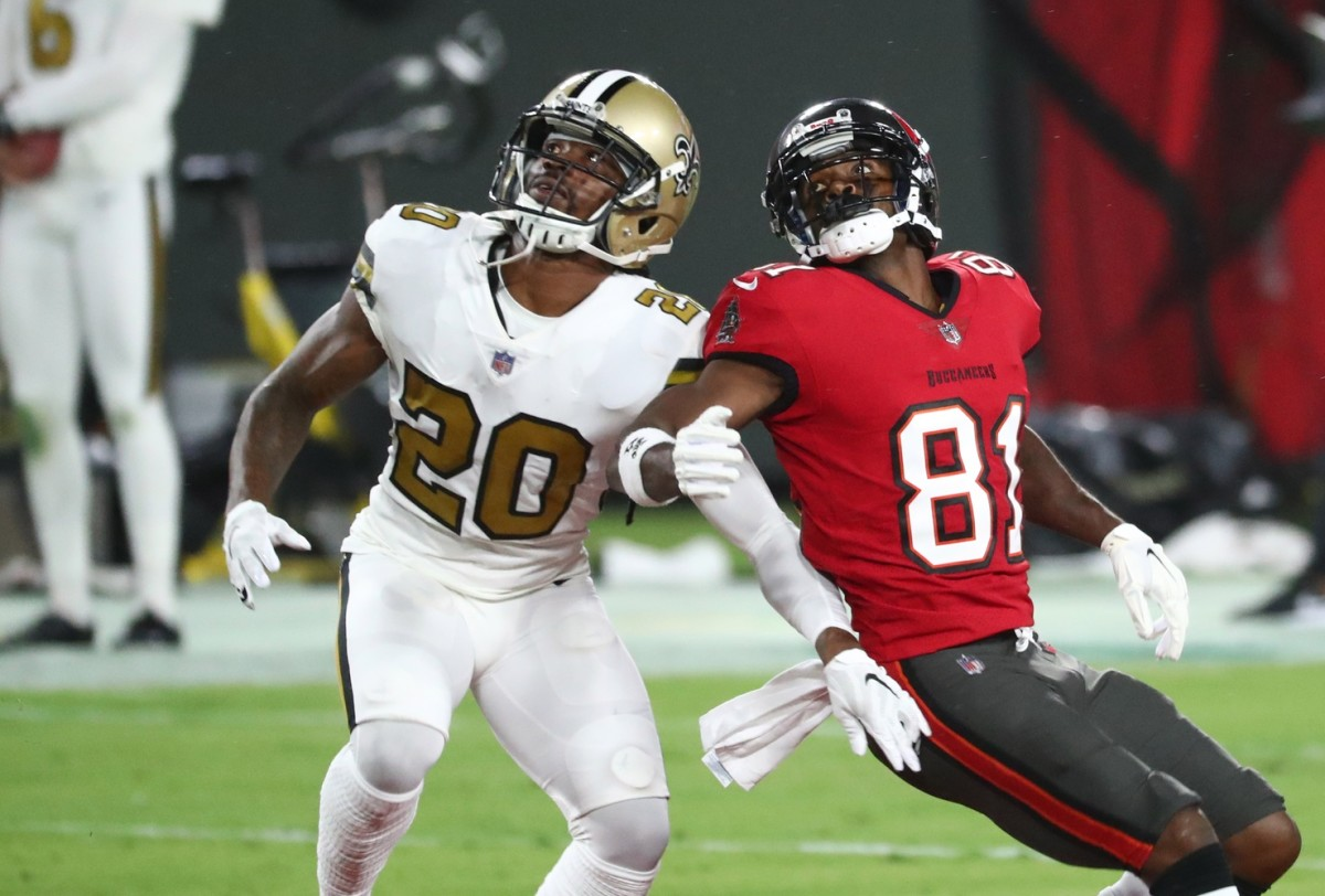 Nov 8, 2020; Tampa, Florida, USA; Tampa Bay Buccaneers receiver Antonio Brown (81) and New Orleans Saints cornerback Janoris Jenkins (20) look up for a pass in the first quarter of a NFL game at Raymond James Stadium. Mandatory Credit: Kim Klement-USA TODAY