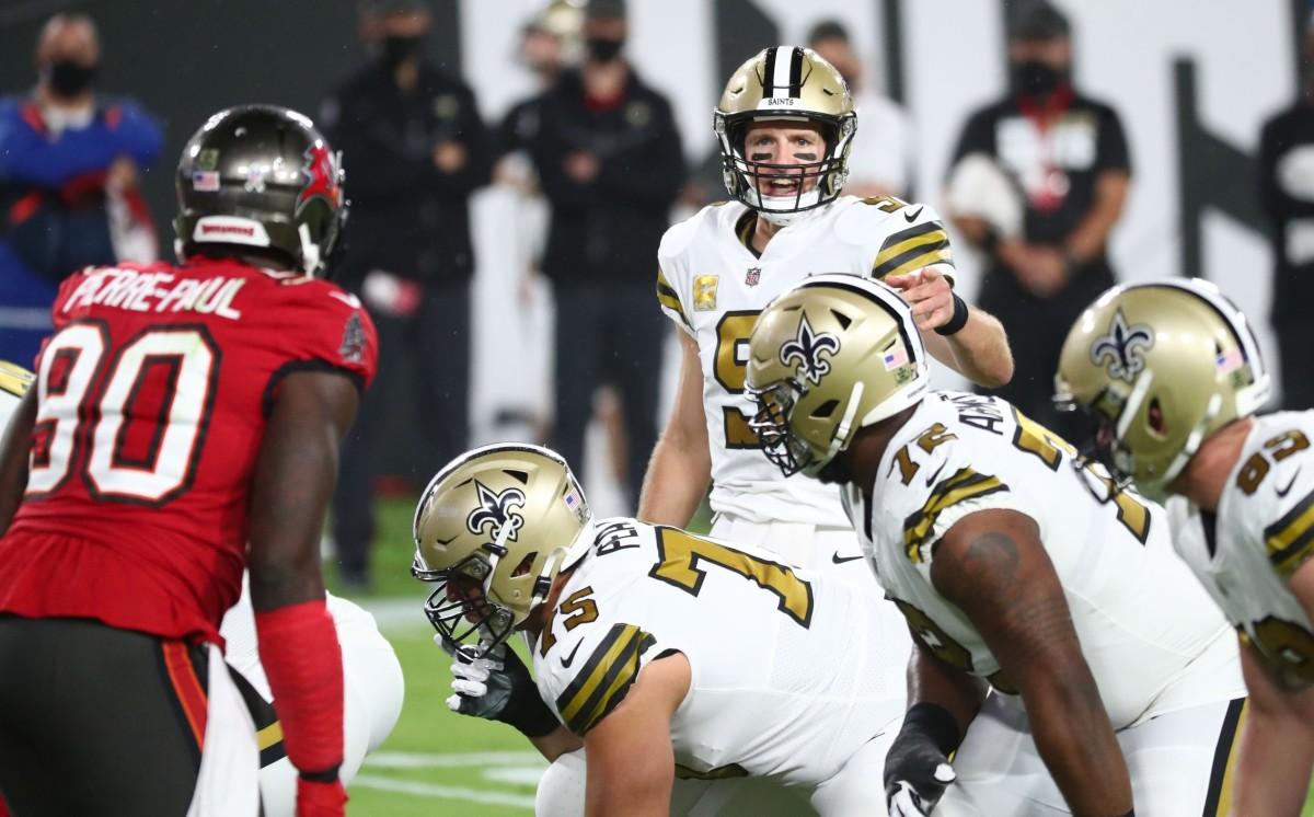 Nov 8, 2020; Tampa, Florida, USA; New Orleans Saints quarterback Drew Brees (9) gestures before a snap as Tampa Bay Buccaneers outside linebacker Jason Pierre-Paul (90) looks on in the first quarter of a NFL game at Raymond James Stadium. Mandatory Credit: Kim Klement-USA TODAY
