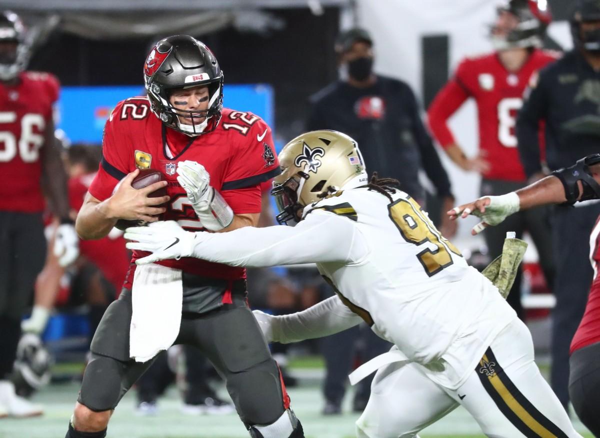 Nov 8, 2020; Tampa, Florida, USA; New Orleans Saints defensive tackle Malcom Brown (90) sacks Tampa Bay Buccaneers quarterback Tom Brady (12) during the second half at Raymond James Stadium. Mandatory Credit: Kim Klement-USA TODAY