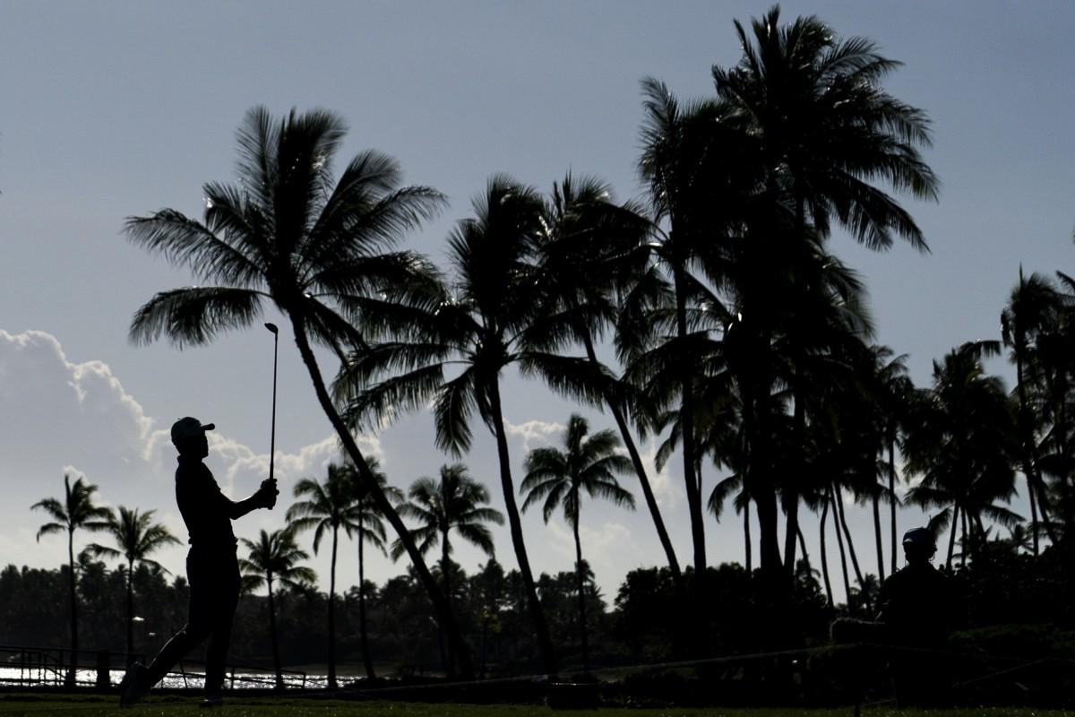 Collin Morikawa against the Hawaii sunset