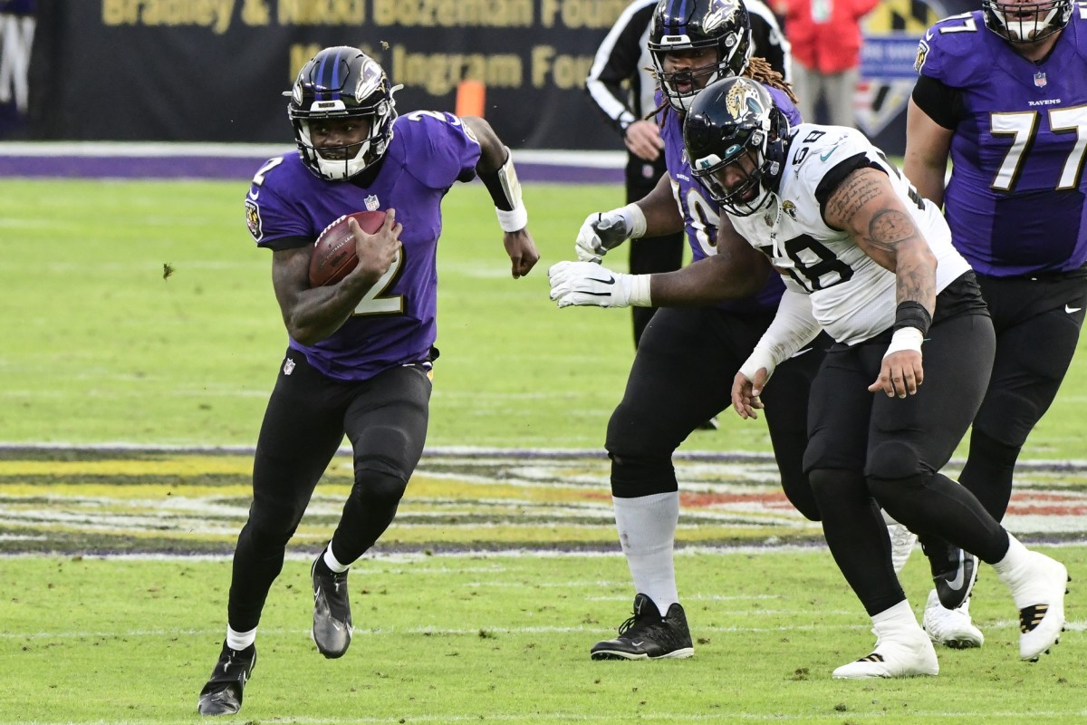 Dec 20, 2020; Baltimore, Maryland, USA; Baltimore Ravens quarterback Tyler Huntley (2) runs during the fourth quarter against the Jacksonville Jaguars at M&T Bank Stadium.