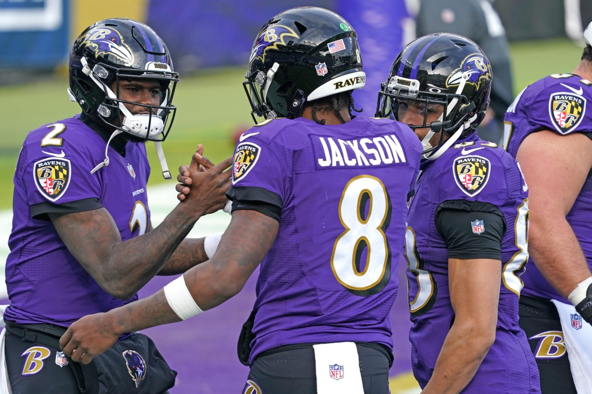 Dec 20, 2020; Baltimore, Maryland, USA; Baltimore Ravens quarterback Lamar Jackson (8) greets quarterback Tyler Huntley (2) prior to a game against the Jacksonville Jaguars at M&T Bank Stadium.