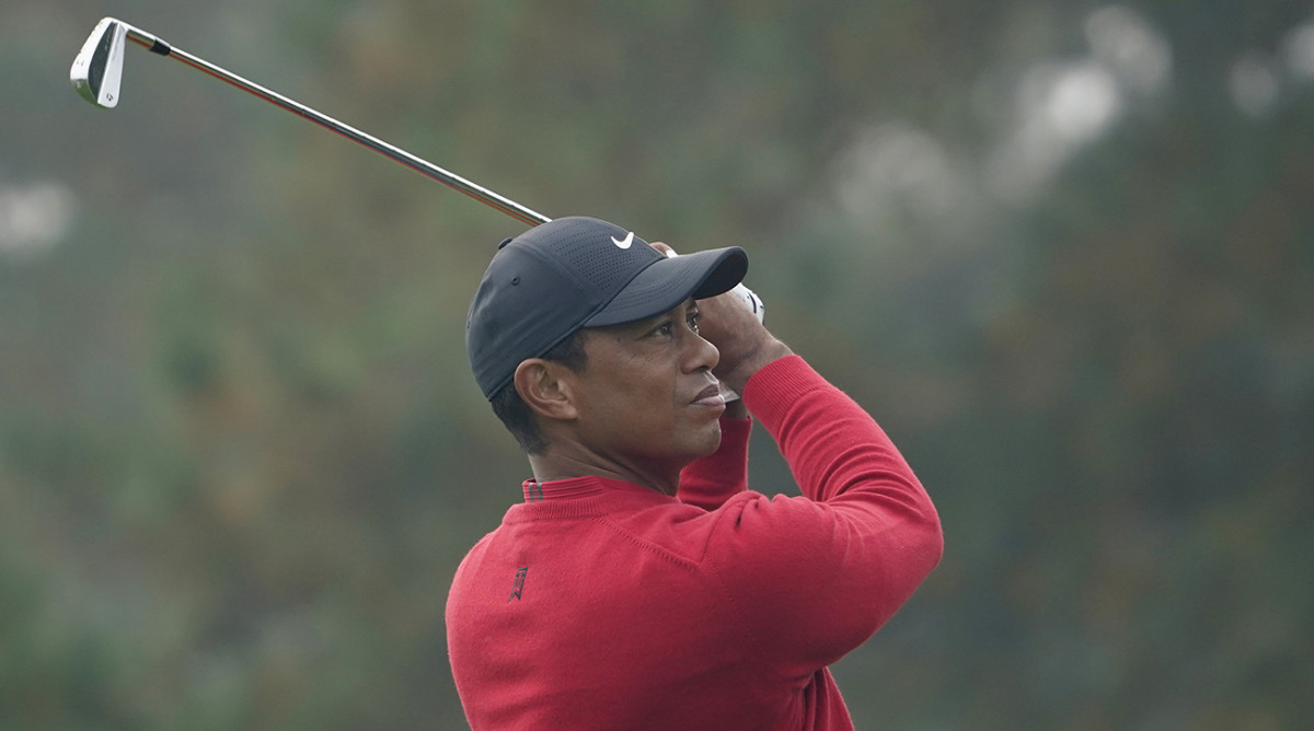 Tiger Woods playing his shot