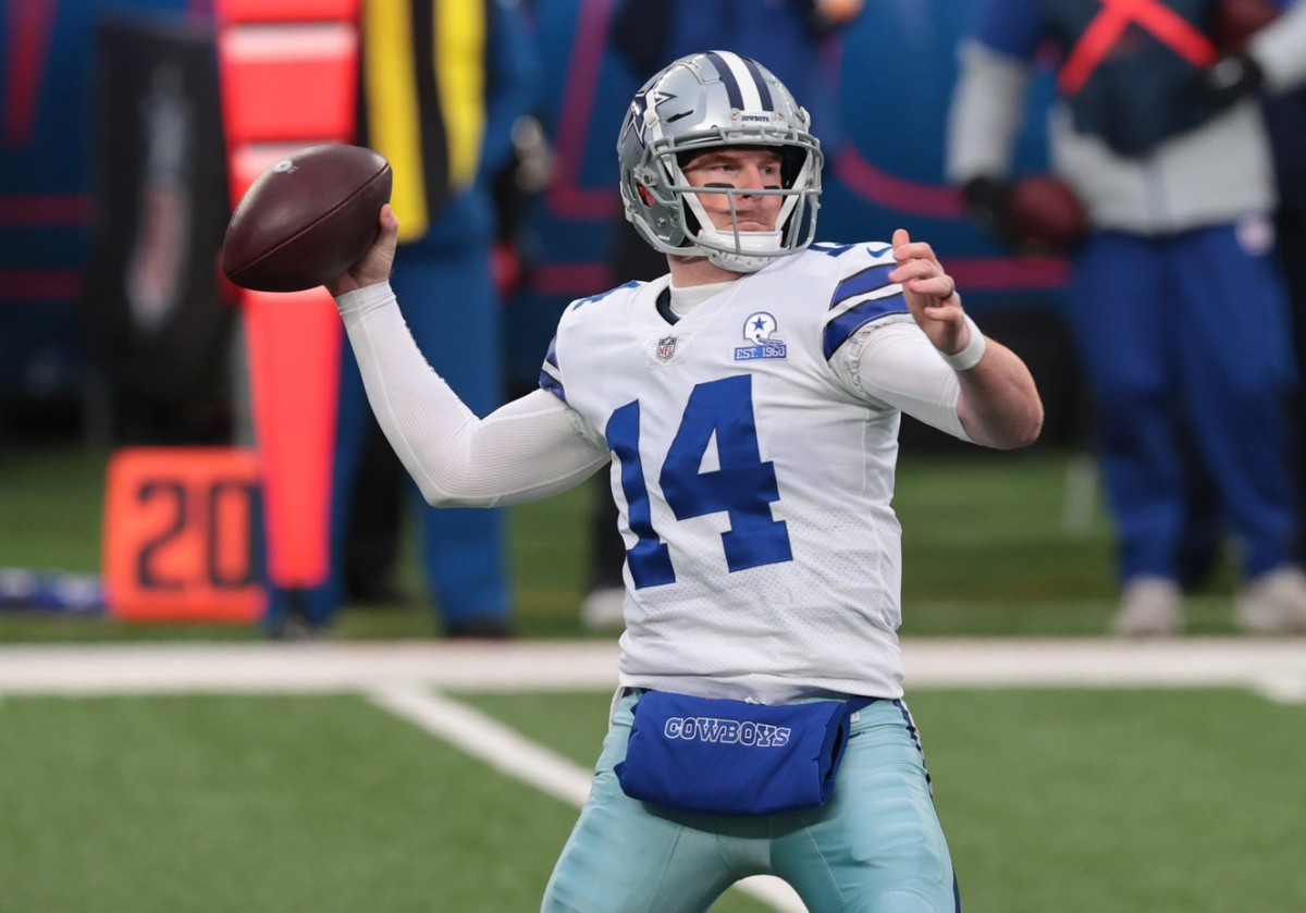 Dallas Cowboys quarterback Andy Dalton (14) throws a pass against the New York Giants in the first half at MetLife Stadium.